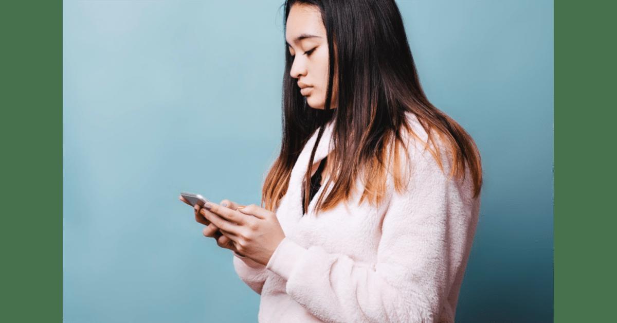 woman looking at phone screen